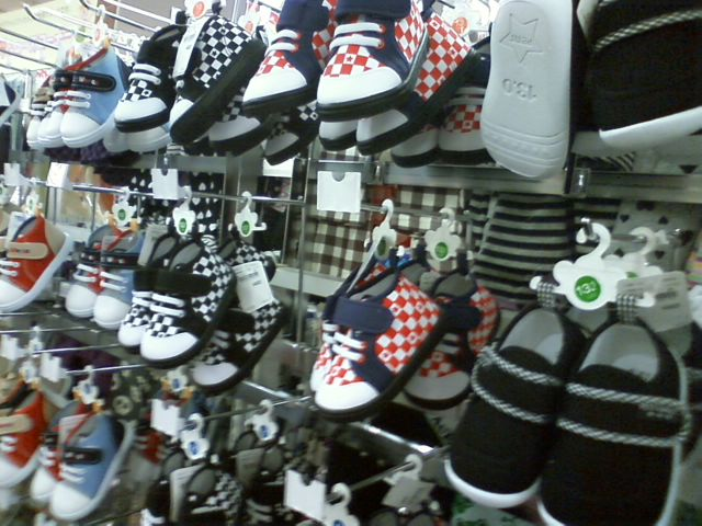 row of baby shoes